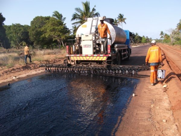 Men doing road maintenance with ehavy machinery in rural Ethiopia.