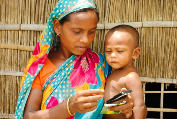 A Bangladeshi woman holding her son.