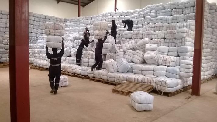 Aid workers handling bundles of supplies