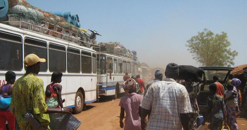 People walking along a busy road in Uganda.