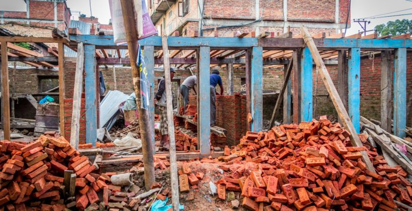 Destroyed dwelling being repaired in Nepal.