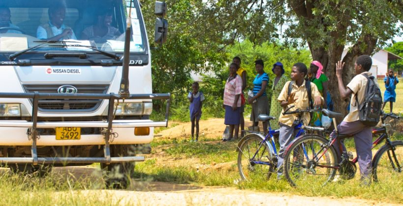 Children looking at a delivery truck in Zimbabwe.