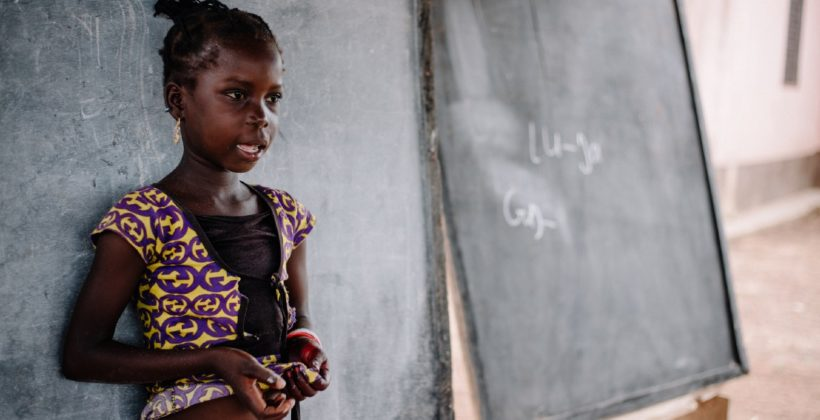 A student participates in a lesson at her community school