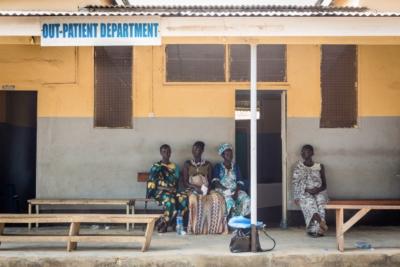 Pregnant women wait outside a clinic