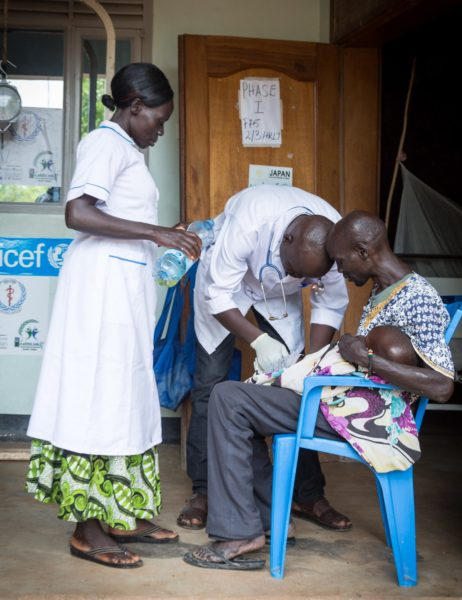 Health staff treat a child at clinic in South Sudan