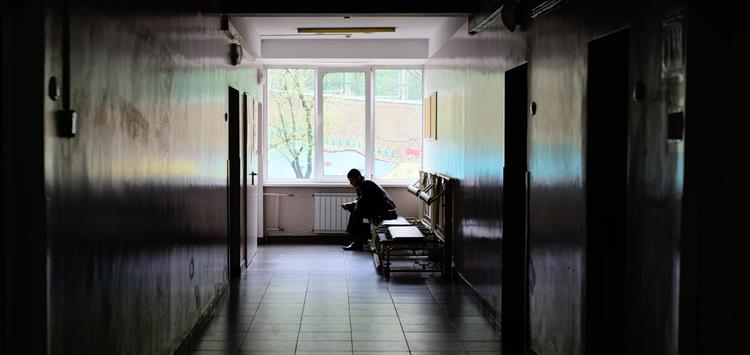 Photo of Ukrainian man sitting in hospital corridor
