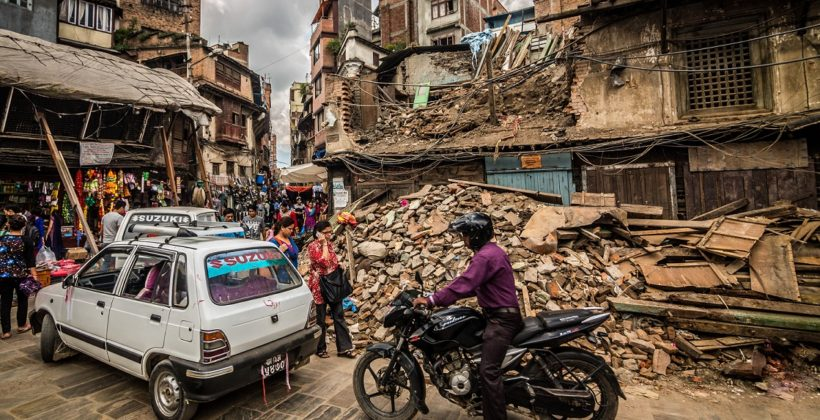 A bicycle passes an earthquake wreckage in Nepal
