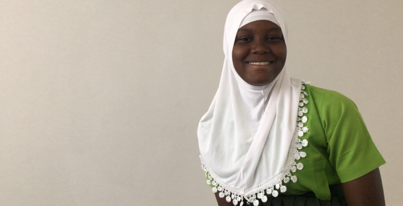 Arahina, a student, smiles at the camera