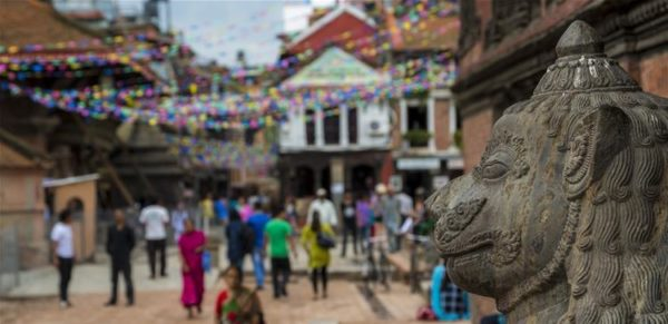 A statue and a busy street in Nepal.