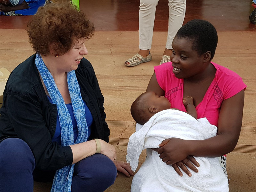 Photo of Chair Marie Staunton with a patient in Zimbabwe